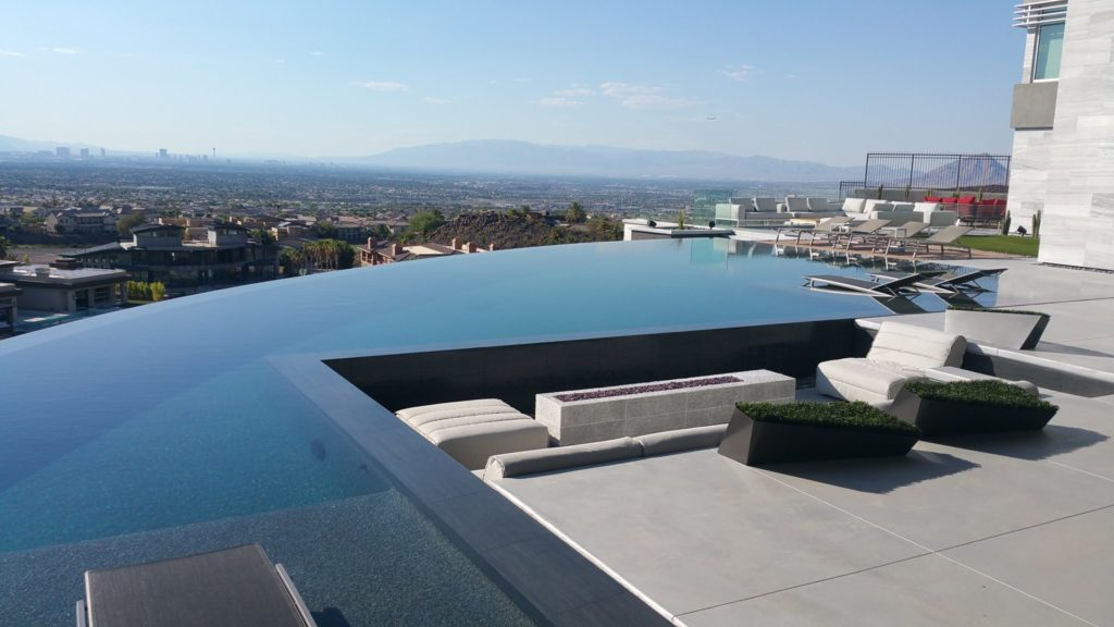 A panoramic backyard view featuring glass rail systems, Majestic Rim - MacDonald Highlands